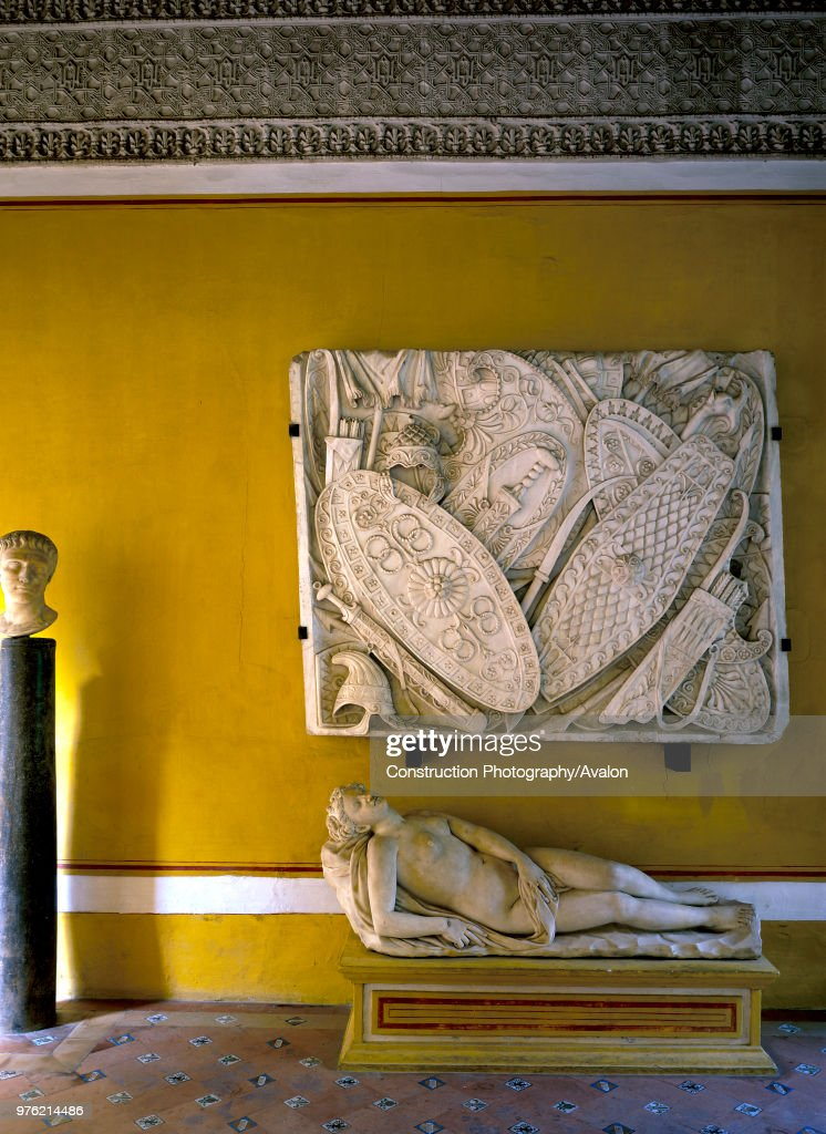 Wall art mounted on wall with naked statue Pictures | Getty Images