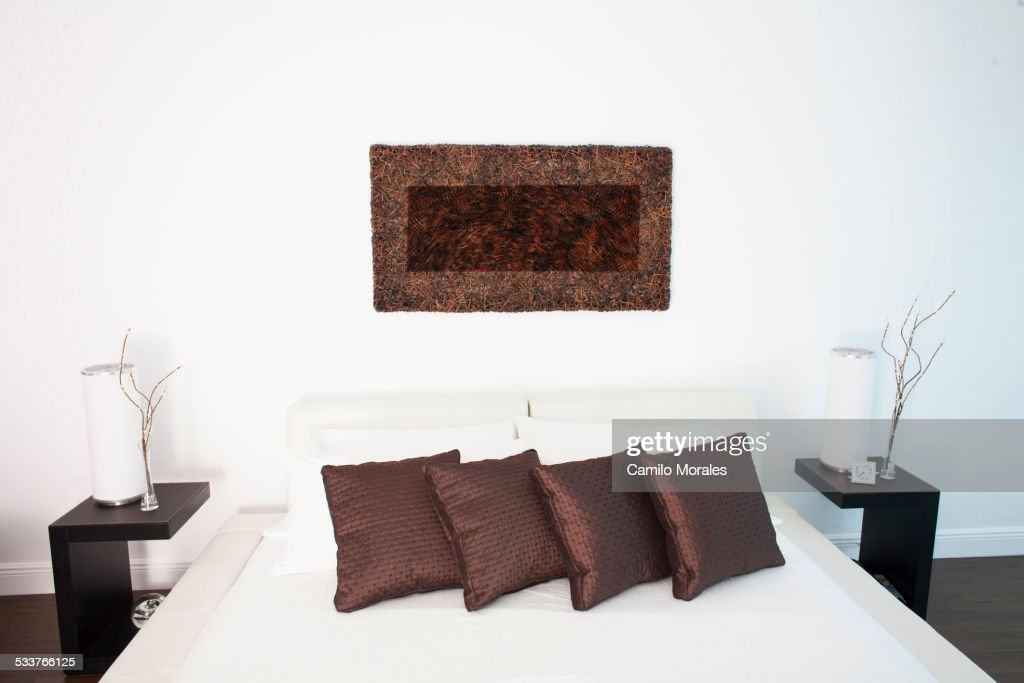Wall art, night tables and bed in modern bedroom : Foto stock
