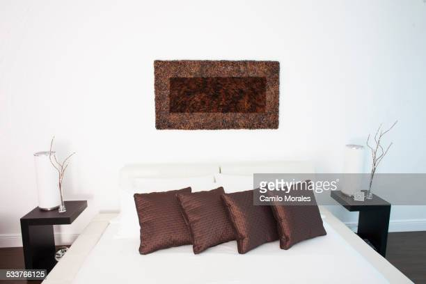 Wall art, night tables and bed in modern bedroom