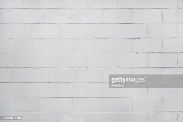 wall background - ziegelmauer stock-fotos und bilder