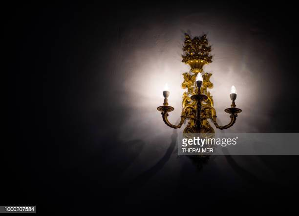 wall candelabrum - candlestick holder stock pictures, royalty-free photos & images