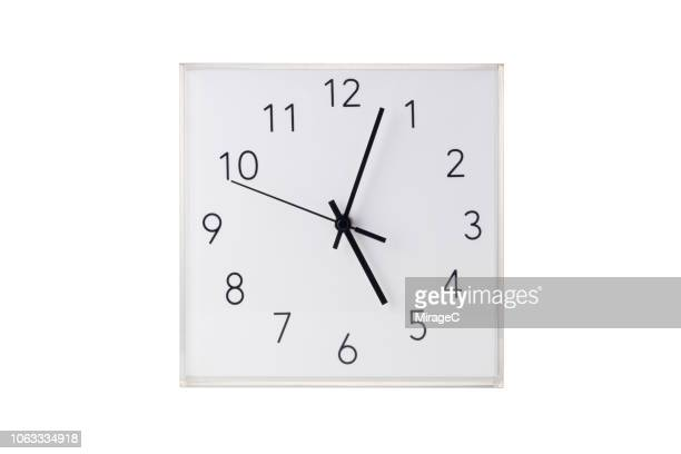 wall clock on white - wall clock stock photos and pictures