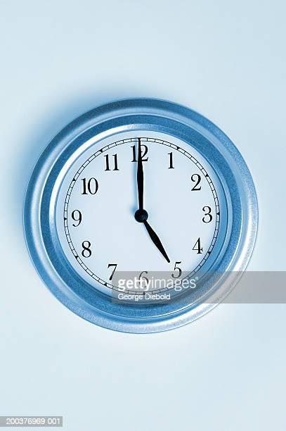 Wall clock showing five o'clock