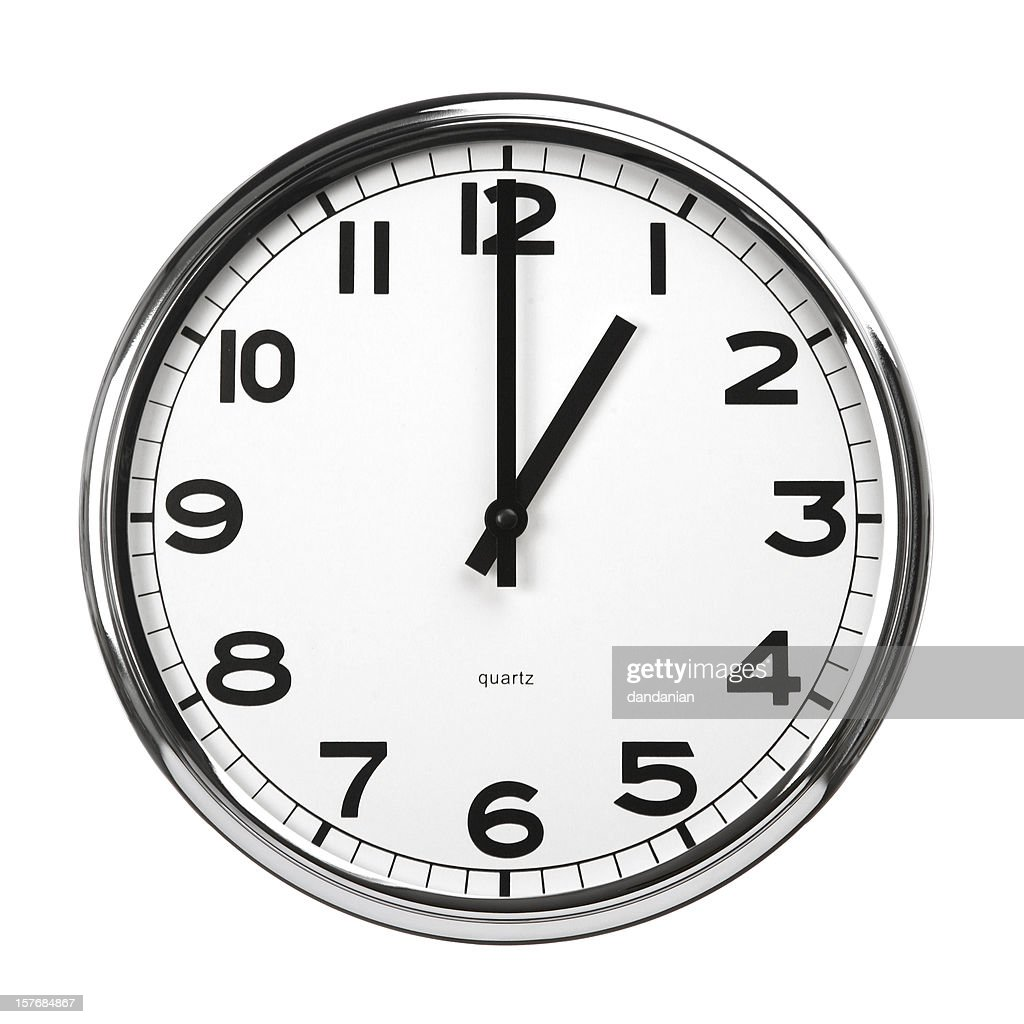 Wall Clock With Metal Surround Hands Read 1 Oclock Stock Photo