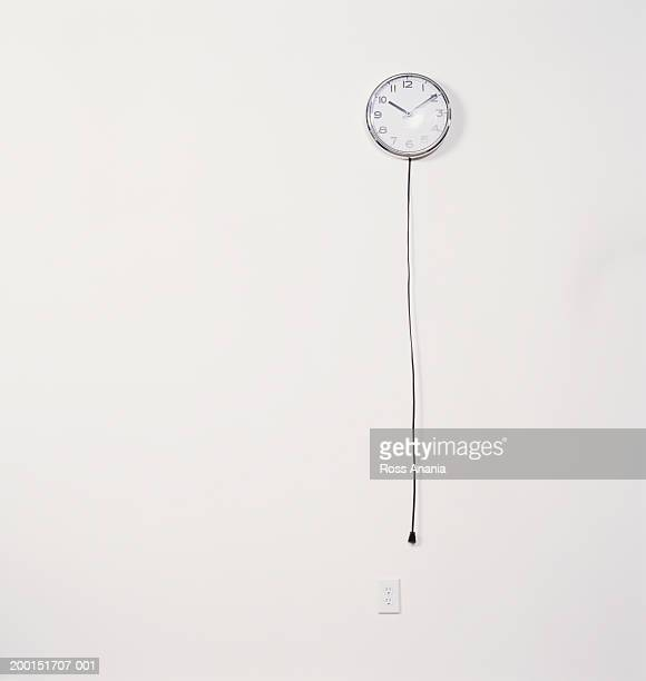 Wall clock with unplugged electric cord