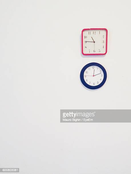 Wall Clocks Against White Background