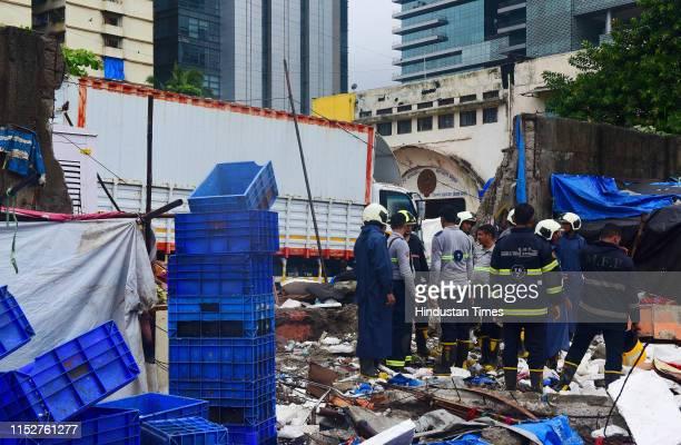 Wall collapsed of Kamgar Krida Bhavan at Tulsi Pipe road after a heavy rain on June 28 2019 in Mumbai India Several areas of Mumbai woke up to heavy...