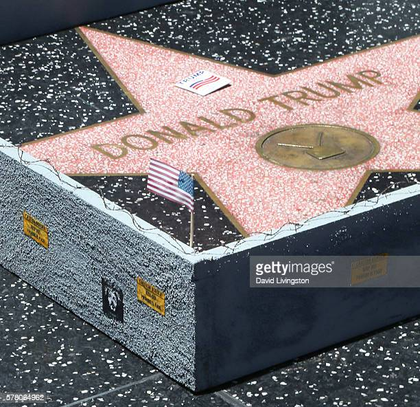 A wall constructed by the artist known as Plastic Jesus is placed around the Hollywood Walk of Fame Star of Donald Trump on July 20 2016 in Hollywood...