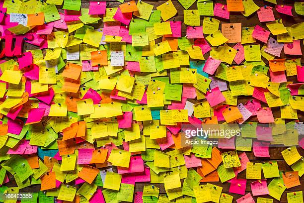 wall covered in post it notes - excess stock photos and pictures