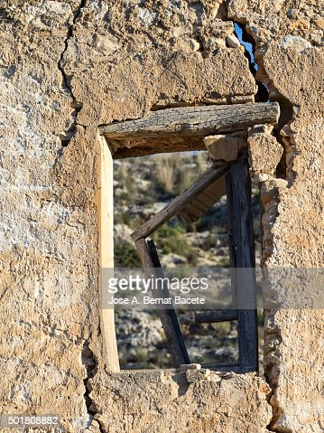 Wall Damaged By The Passage Of Time Of A Former House With A