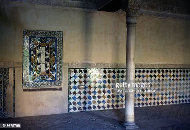 Wall decorated with azulejos inside the Alhambra Granada Andalucia Spain 14th century