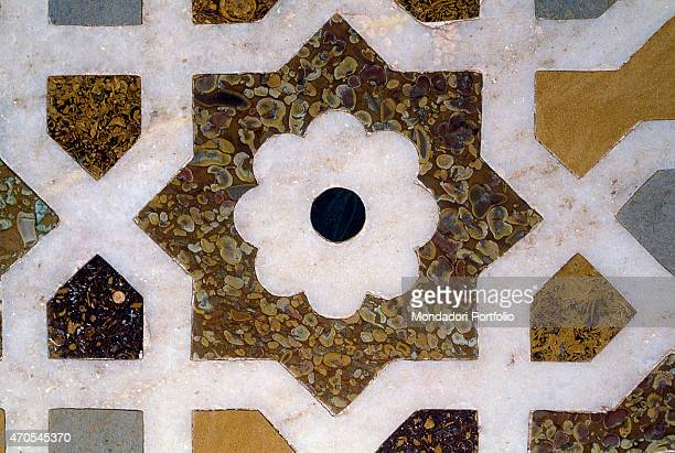'Wall decoration by Mughal craftsmen 16221628 17th Century marble fire marble gemstones inlay India Agra Detail A white marble flower in the stands...