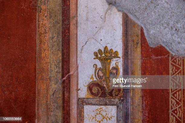 wall decoration inside one of the bath houses in the city of pompeii italy - finn bjurvoll stock-fotos und bilder