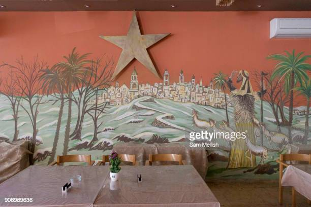 A wall display showing the Christian Nativity in a restaurant on Bethlehem Square on 1st April 2016 in Bethlehem West Bank During the Palestine...