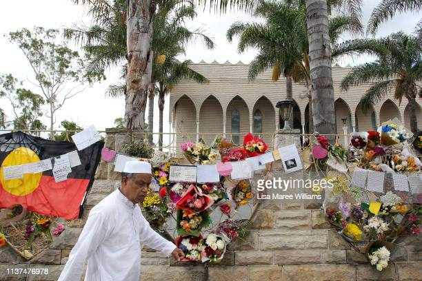 A wall displays flowers and messages for the victims of the Christchurch attacks at the Lakemba Mosque on March 22 2019 in Sydney Australia 50 people...