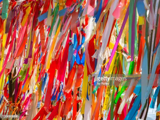 wall full of ribbons of different colors moving in the wind - multiculturalism stock pictures, royalty-free photos & images