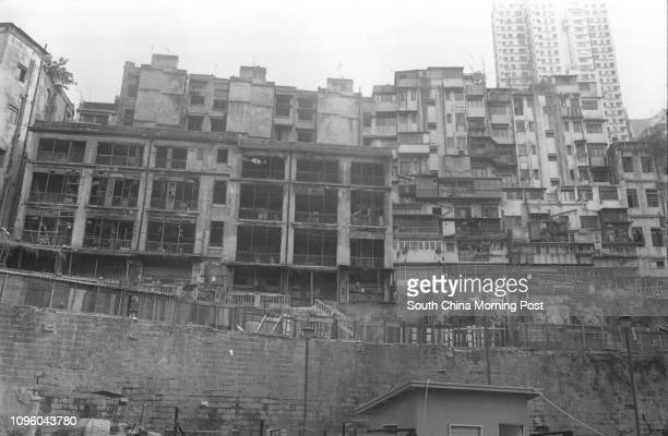 Wall in danger of collapsing and the endangered buildings in Hollywood Road. 23AUG77