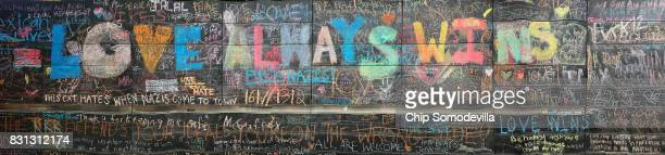 A wall is covered with chalk writing outside city hall as an informal memorial August 14 2017 in Charlottesville Virginia Charlottesville is now...