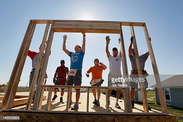 Wall is raised on a Habitat for Humanity house being built to replace one that was destroyed one year ago today after the town was hit by a...