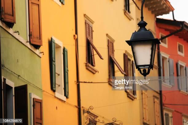 Wall lantern and yellow houses