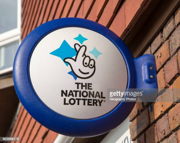 Wall mounted sign for the National Lottery Amesbury Wiltshire England UK