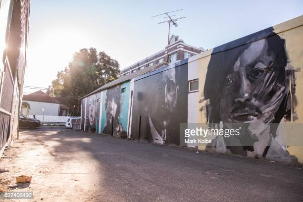A wall mural by artist Brad Robson of fashion designer Akira Isogawa poet Henry Lawson athlete Annette Kellerman and drag queen Betty Grumble is seen...