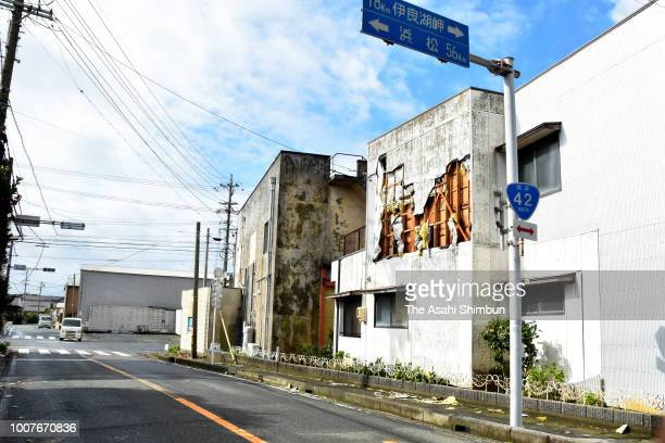 A wall of a building is damaged after Typhoon Jongdari ran past the area on July 29 2018 in Tahara Aichi Japan Strong typhoon Jongdari that made...