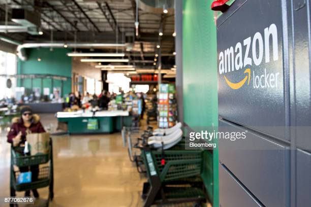 A wall of Amazoncom Inc lockers a selfservice parcel delivery service stand inside the Lakeview Whole Foods Market Inc store in Chicago Illinois US...