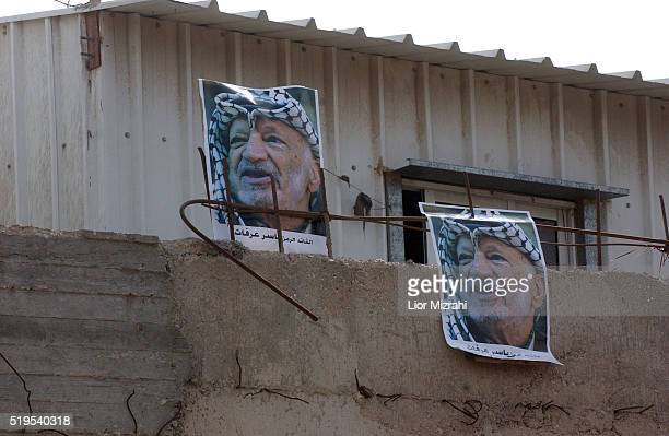 A wall of Arafat posters at the Ramallah compound on Nov 11 2004 Arafat was pronounced dead early this morning Mr Yasser Arafat president of the...