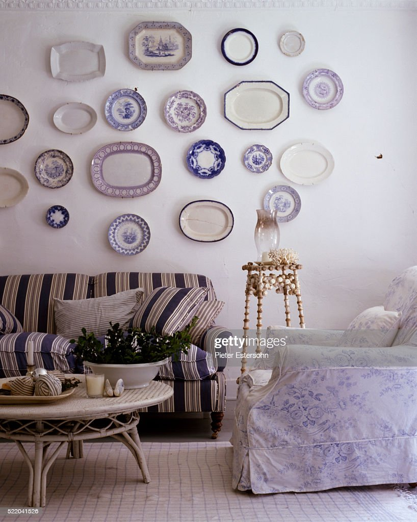 Wall Of Blue And White China Plates Above Country Living Room Furniture High Res Stock Photo Getty Images