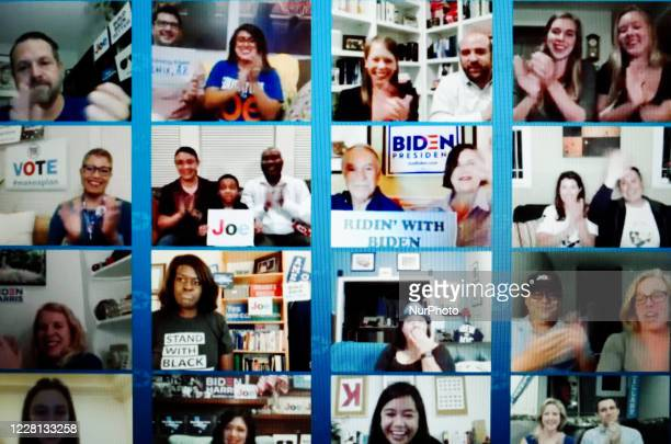 Wall of cheering Democrat supporters' webcams is displayed during the closing moments of the virtual 2020 Democratic National Convention,...