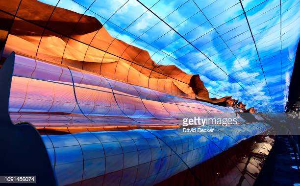 A wall of curved televisions are displayed at the LG booth at CES 2019 at the Las Vegas Convention Center on January 8 2019 in Las Vegas Nevada CES...