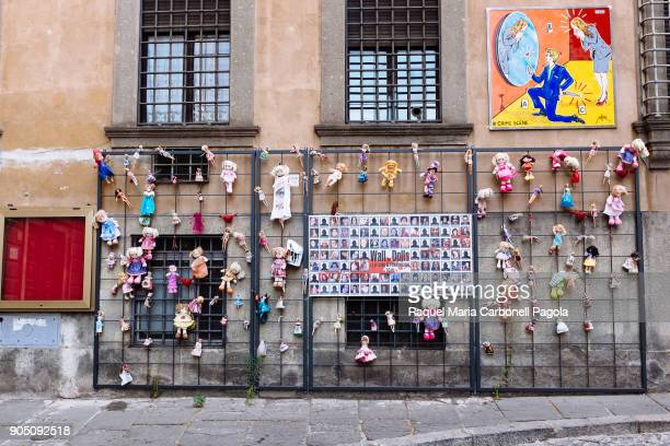 Wall of Dolls Memorial to the victims of femicide in Italy in 2016