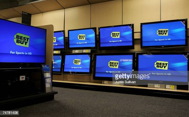 A wall of flat panel televisions are displayed the Best Buy logo at a Best Buy store June 19 2007 in San Francisco California Consumer electronics...
