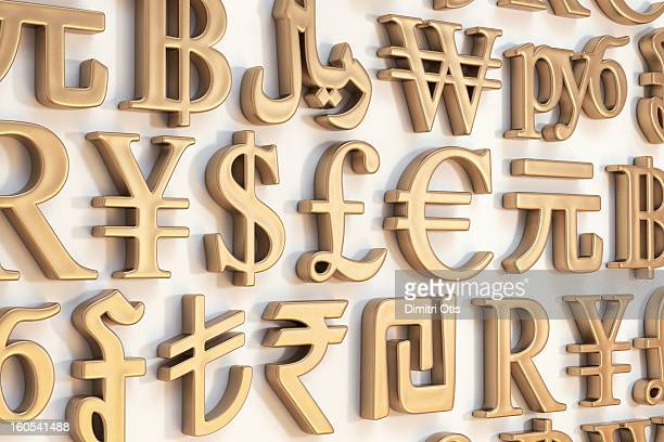 wall of gold international currency symbols - currency symbol stock pictures, royalty-free photos & images