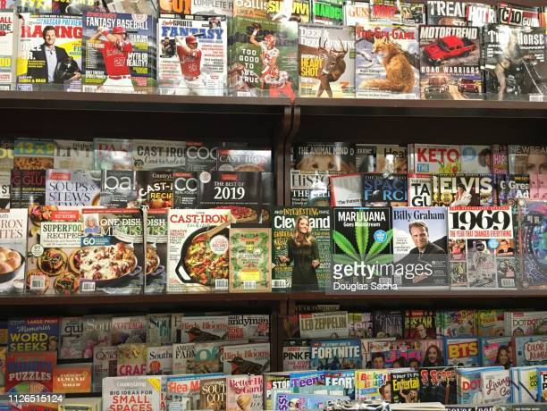 wall of magazines on display - magazine rack stock photos and pictures