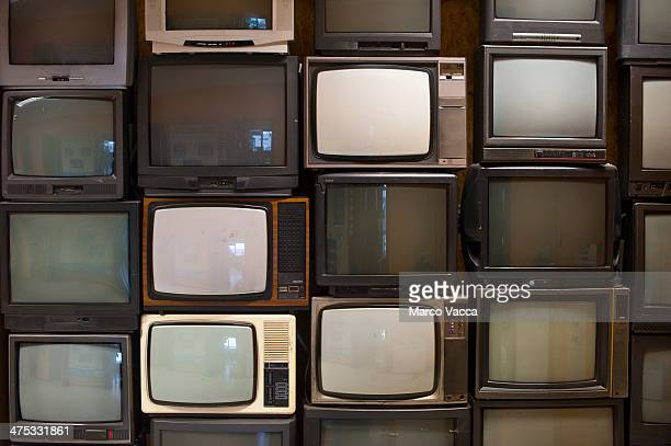 A wall of old TV sets