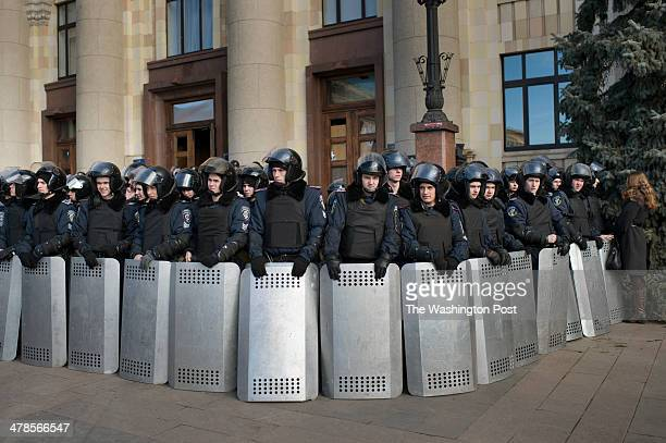 A wall of policemen protect the entrance to the Regional Administration building in Kharkiv Ukraine on Thursday March 13 2014 The building was taken...