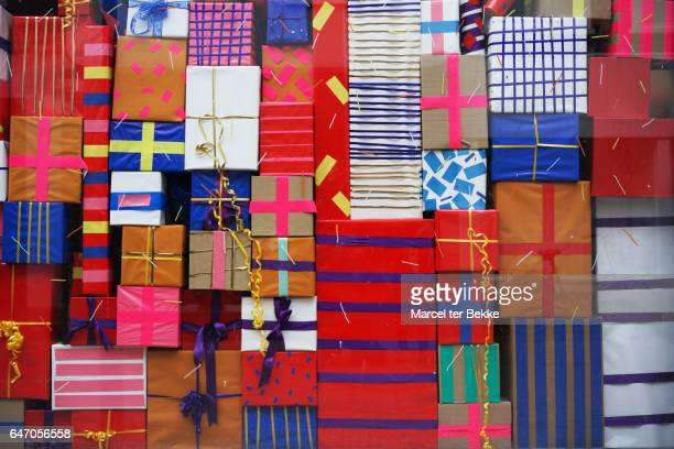 wall of presents - large group of objects stock pictures, royalty-free photos & images