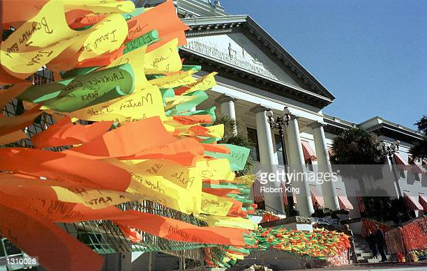 A wall of ribbons in support of Vice President Al Gore blow in the wind outside the capitol building on December 5 2000 in Tallahassee Florida The...