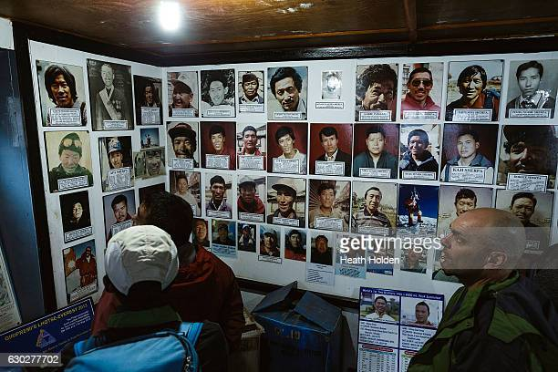 A wall of Sherpa faces who have summited Mt Everest on display at the Sherpa culture museum on September 21 2016 in Namche Bazar Nepal The trails in...
