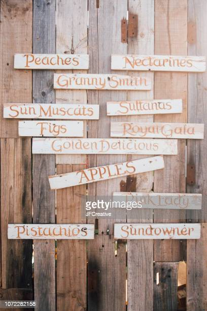 wall of signs - adelaide market stock pictures, royalty-free photos & images