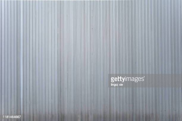 a wall of silver grey stripes - wood panelling stock pictures, royalty-free photos & images