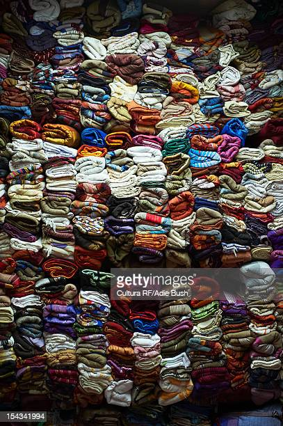 Wall of stacked fabric for sale