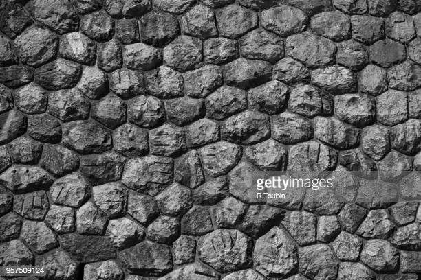 wall of stones as a texture background - stone wall stock pictures, royalty-free photos & images