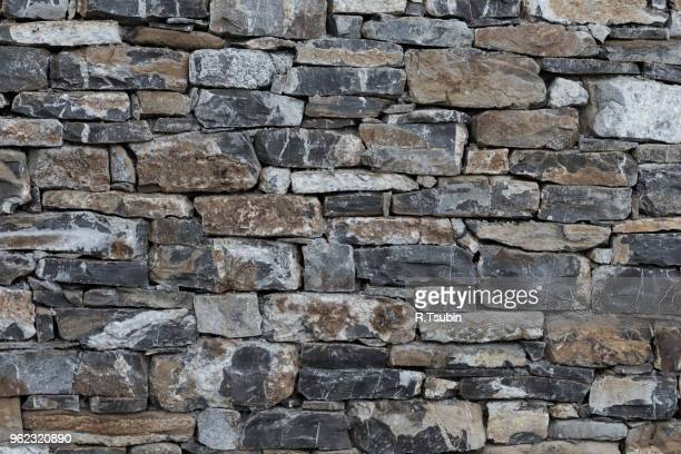 wall of stones as a texture for background - castle wall stock pictures, royalty-free photos & images