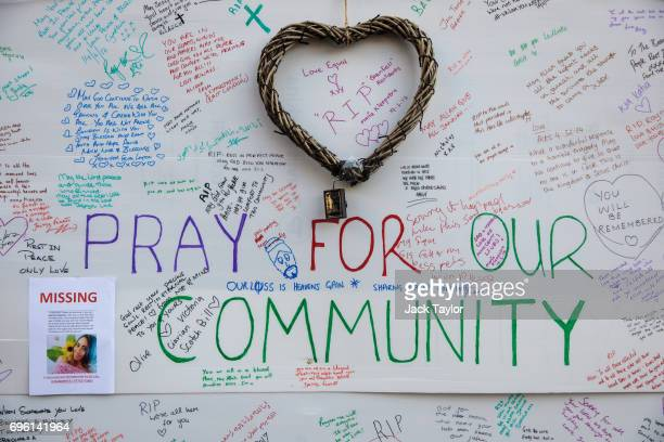 A wall of tributes and messages of condolences for the victims sits on the side of a community centre near to the site of the Grenfell Tower fire on...