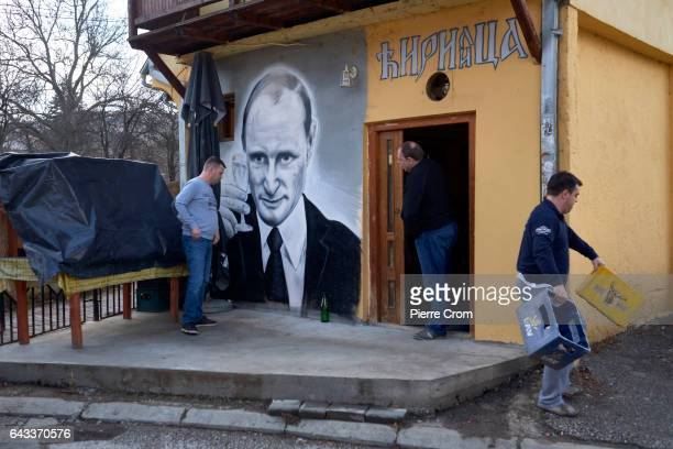 A wall painting depicting Russian president Vladimir Putin is seen on a local coffee house on February 20 2017 in Zvecan Kosovo The new US Trump...