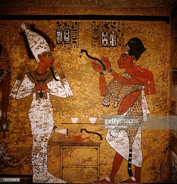 Wall painting from the tomb of Tutankhamun showing King Aye performing the mouth opening ritual on the mummy of Tutankhamun Egypt Ancient Egyptian...