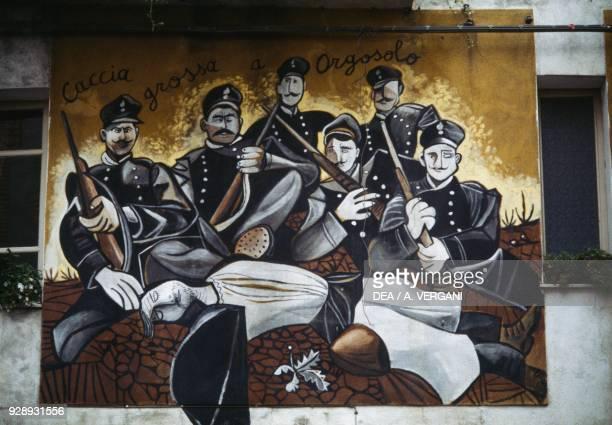 Wall painting in Orgosolo evoking the massacre of Murguliai from 1899 Ollolai Sardinia Italy